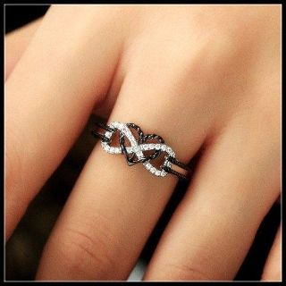 An Exquisite 18K White Gold & Black Heart Two-Tone Ring