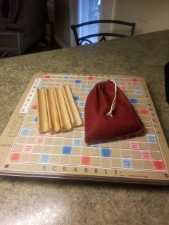 Scrabble Deluxe Turntable Edition, turns easily making it nice when it's your turn no matter which side of the table your sitting.