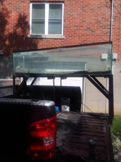 120 gallon fish tank on stand comes with every thing you need and more for fish! Must pick up and will need 3 to 4 people to haul (heavy)