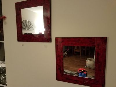 Mirror wall decor with red trim