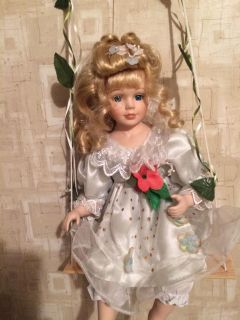 Girl on a swing porcelain doll