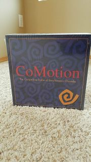 Comotion charade game