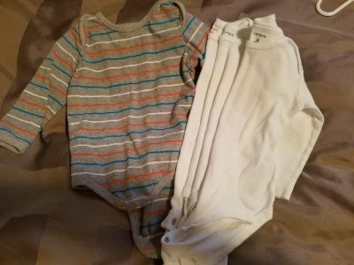 Like new 4 long sleeve onesies. 3 white 6 month Carters