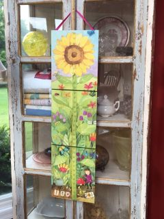 Wonderful boutique folding growth chart. Hangs 24 from floor and is foldable for starge