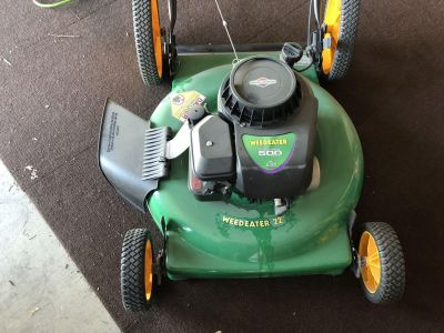 Lawn Mowers--two mowers one new