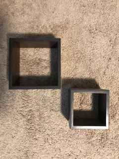 Two brown square wall shelves