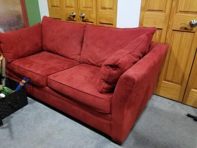 Red microfiber queen-sized sleeper sofa couch