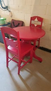Red table with 2 chairs