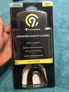 NIP Youth (11-) Champion strapped mouth guard. Braces Compatible/Black