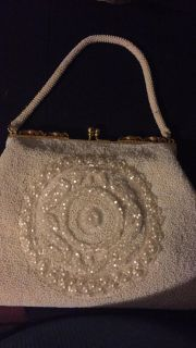Vintage hand beaded clutch. With sequins design beautiful.