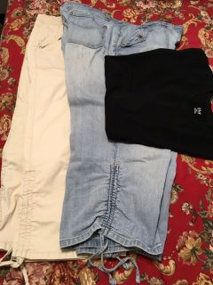 2 capris and one black large short sleeve top