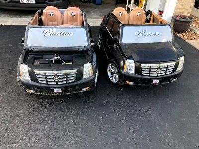 two Cadillac power wheels