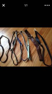 6 assorted belts and a purse strap lot