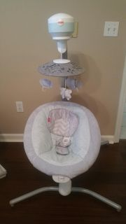 Fisher Price Swing, gender neutral, has a plug in and battery pack