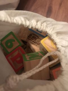 Huge bag full of wooden blocks numbers and letters