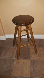 Beautiful stained spin top seat stool