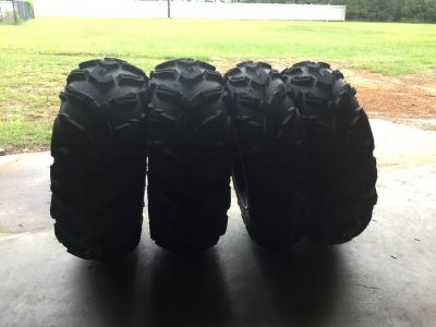 4 new Maxxis Mu26 ATV mud tires mounted on rims