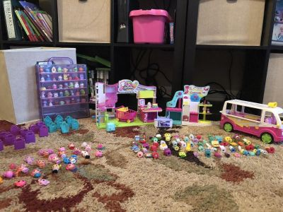 115 shopkins, case, and accessories. 22 small lalaloopsy dolls.