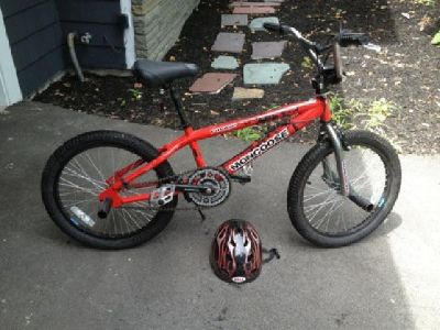 "$45 20"" Mongoose Ravage BMX Bike with helmet"