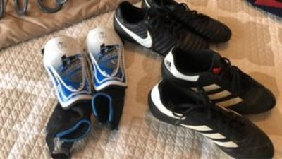 size 8.5 Nike and Adidas soccer cleats and Medium Shin guards