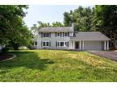 Exceptional, totally renovated from top to bottom lake-front Colonial set back
