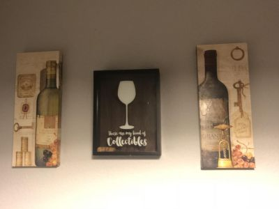 Cork holder & two wine pictures.