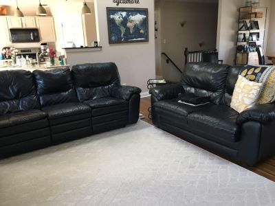 Black leather-like couch and loveseat