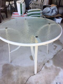 GLASS TOP PATIO TABLE. No chairs