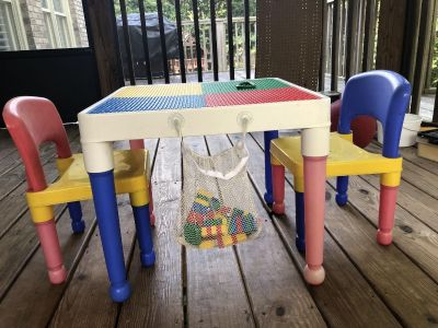 LEGO table with chairs and LEGO bag