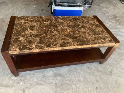 Solid wood granite topped coffee table.