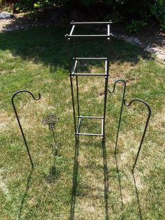 Lot of five wrought iron lawn ornament items