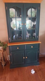 Hunter green and wood grain dining hutch