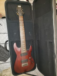 Schecter omen 8 string guitar with case and amp chord.