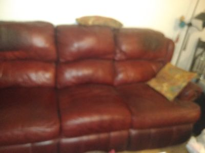 LARGE MAROON LEATHER SOFA RECLINERS ON EACH END