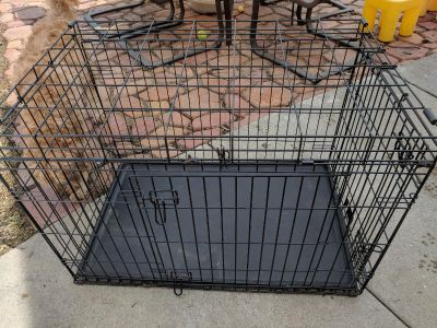 Black dog kennel. Minor rust but structurally sound.