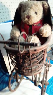 Antique stroller and bear