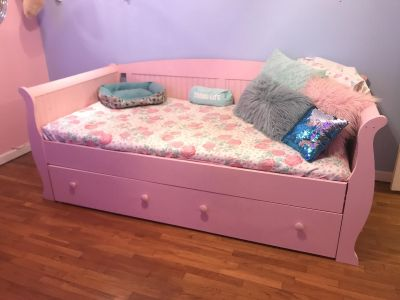 Pink twin trundle bed
