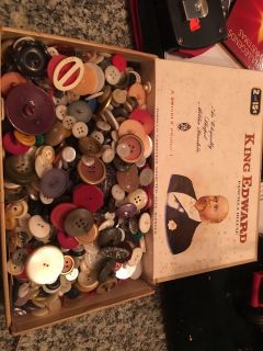 Old cigar box filled with buttons