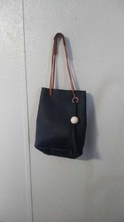 Brand new bag...straight out of plastic black and tassle on side