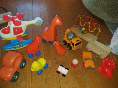 Assorted toys free infront of my car in a box