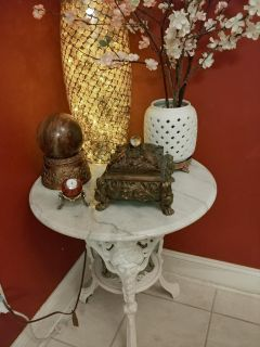Antique iron and marble pub table.