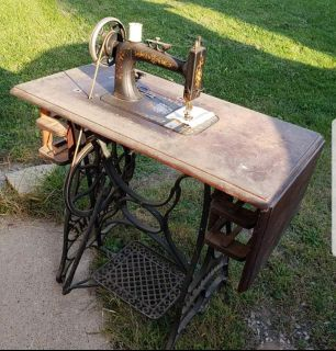 Late 1800's (1889) New Home antique sewing machine and cabinet with accessories and cover