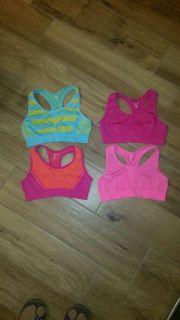 Lot of 4 Pink Cookie sports bras. Never worn. Size small. (Look like a 7/8 girls?)