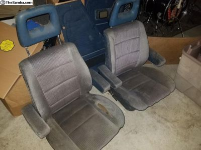 Blue vanagon pair of front seats with armrests.