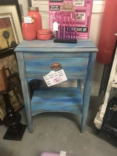 Blue bohemian style end table with lined drawer