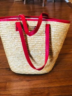 Woven beach tote with red leather like handles