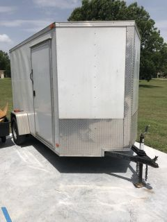 Utility trailer with motorcycle cradle