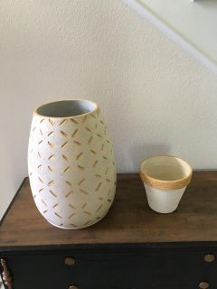 Two white and gold vases
