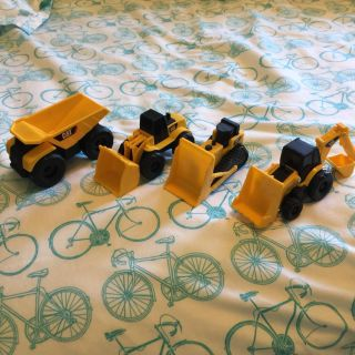 Set of 4 CAT Construction vehicles. Approx 2 inches each.