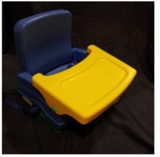 Booster Seat. Seat belt and secure tray.